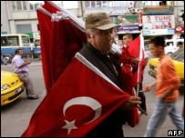 A man carries Turkish flags in Ankara. File photo
