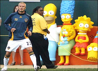David Beckham warms up in front of the Simpsons