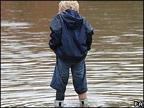 Boy in flood waters