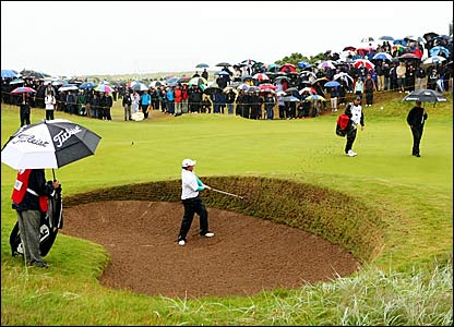 Northern Ireland amateur Rory McIlroy chips out of a greenside bunker on the first
