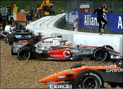 Lewis Hamilton's McLaren (centre) in a busy gravel trap