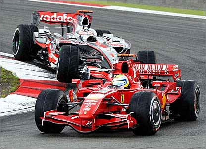 Ferrari's Felipe Massa leads from Fernando Alonso