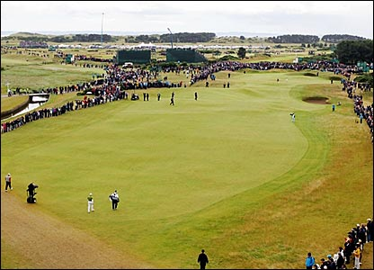 Sergio Garcia (in green, bottom left) strolls down the first at Carnoustie
