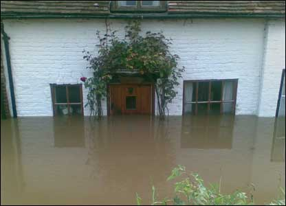 Floods at a cottage at King Johns Bridge in Tewkesbury