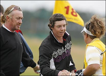 Miguel Angel Jimenez looks on as Rory McIlroy shakes hands with Fanny Sunneson