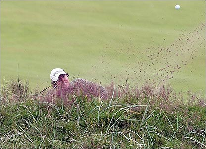 Rory McIlroy plays out of a bunker