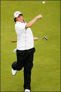 Rory McIlroy throw his ball to the crowd