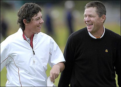 Rory McIlroy enjoys a laugh with playnig partner Scott Verplank