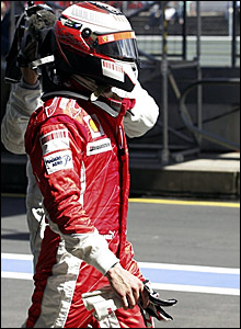 Kimi Raikkonen walks back to the pits