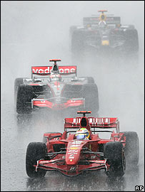 Felipe Massa heads Fernando Alonso and David Coulthard in the pouring rain at the Nurbugring