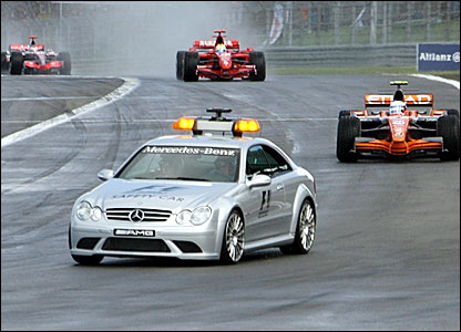 The safety car leads the cars round the track