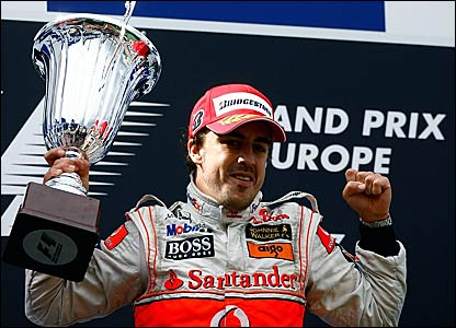 Fernando Alonso celebrates his win at the European Grand Prix