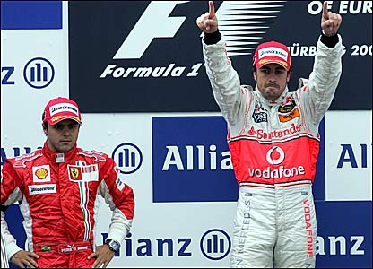 Ferrari's Felipe Massa (left) on the podium with race winner Fernando Alonso