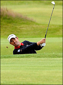 Padraig Harrington plays out of a bunker