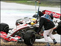 Lewis Hamilton's car is winched back on to the track during the European Grand Prix