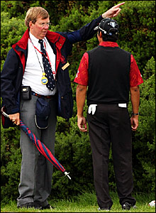 A Royal & Ancient official tells Anders Romero where to drop his ball after finding gorse on the 12th