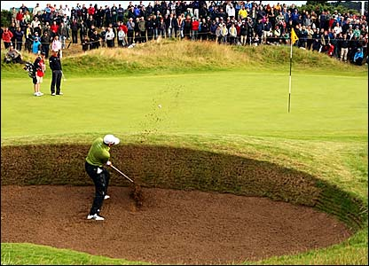 Sergio Garcia plays out of a greenside bunker on the first play-off hole