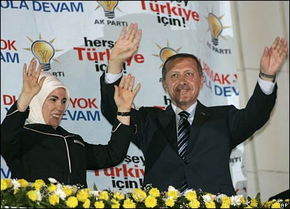 Turkish Prime Minister Recep Tayyip Erdogan (right) and his wife Emine Erdogan greet supporters in Ankara