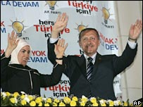 Prime Minister Recep Tayyip Erdogan (right) and his wife Emine greet supporters in Ankara