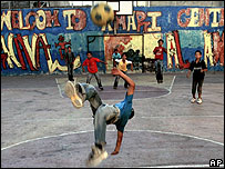 Children play football in a refugee camp in Ramallah, West Bank