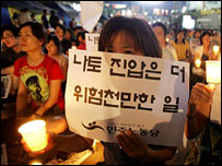South Korean anti-war protestor holds a banner at a vigil in Seoul on 22 July