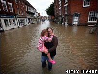 A woman and her daughter in flooded areas of Tewkesbury, Gloucestershire