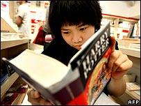 A fan reads a copy of the new Harry Potter novel