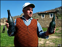 Farmer shows bottles in Macedonian village