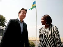 Conservative leader David Cameron met by Senator Agnes Mukabaranga, as he arrives at Kigali airport.