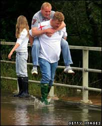 People battle through floodwater in Upton