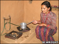 A woman using a biogas stove (Image: Martin Wright)