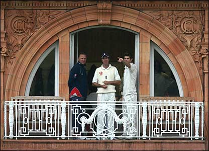 Allan Donald, Michael Vaughan and James Anderson on the balcony at Lord's