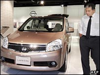 Customer looking at Nissan compact Lafesta mini-van in showroom