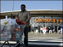 Shopper outside Sainsbury's store