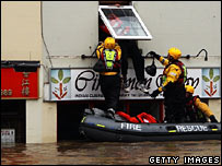 Evesham resident being rescued from the floods