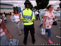 People taking bottled water supplies