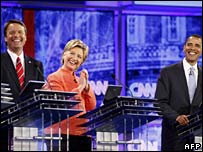 John Edwards, Hillary Clinton and Barack Obama laugh during the debate