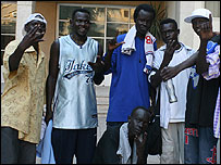Aywel Jonathan (second left) with other Sudanese refugees