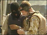 Iraqi interpreter and British soldier