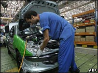 Worker assembling Peugeot car