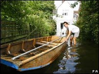 An Oxford resident pulls his boat into his garden
