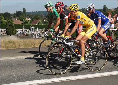 Michael Rasmussen rides in the peloton