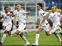 Iraq's players celebrate their semi-final victory