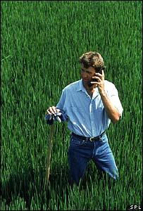 Farmer makes mobile call in a field