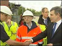 Prime Minister Gordon Brown (far right) meets emergency workers