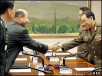 North Korea's chief delegate, Lt. General Kim Yong Chol (R) shakes hands with his South Korean counterpart Jeong Seung-jo
