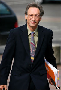 Chris Langham arriving at court on 26 July