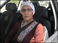 Majda at the wheel of her taxi