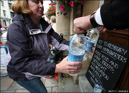 Water bottles are distributed outside the Town Hall in Tewkesbury, 23 July 2007
