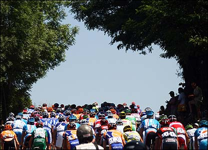 The Tour heads through the tree-lined countryside